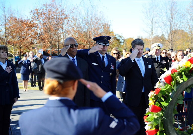 From left to right, retired Gen. Larry O. Spencer, the Air Force Association president; Lt. Gen. Mark A. Ediger, the Air Force surgeon general; and retired Chief Master Sgt. Mark A. Stevenson, the Air Force Sergeants Association chief operating officer, present a salute during a wreath laying ceremony as part of the Veterans Day event at the Air Force Memorial Nov. 11, 2015. (U.S. Air Force photo/Tech. Sgt. Bryan Franks)