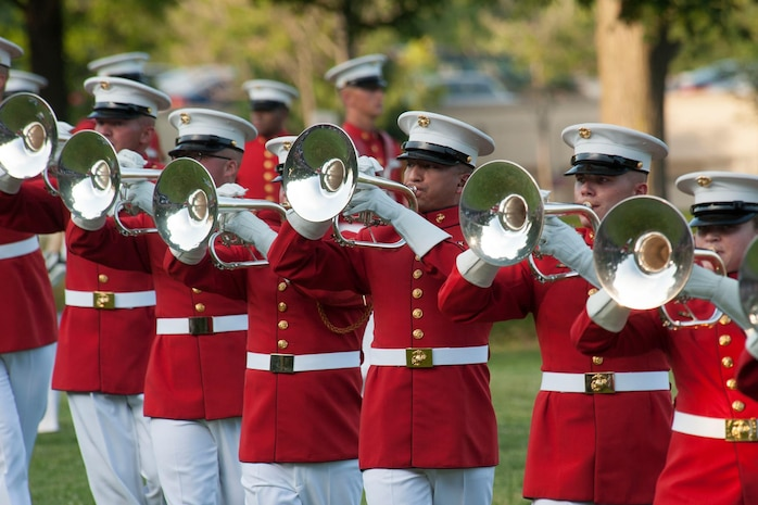 "Members of ""The Commandant's Own"" mellophone bugle section perform during the ""Music in Motion"" drill show. (U.S. Marine Corps photo by Lance Cpl. Kayla McTaw/Released)"