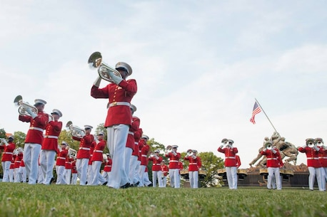 "Members of ""The Commandant's Own"" baritone bugle section perform during the Sunset Parade held in Arlington, Virginia at the Marine Corps War Memorial. (U.S. Marine Corps photo by Lance Cpl. Alejandro Sierras/Released)"