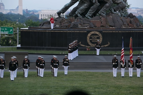 """Preparing to play """"Taps"""" Staff Sergeant Codie Williams overlooks the ceremonial marchers from the base of the Marine Corps War Memorial. (U.S. Marine Corps photo by Staff Sgt. Oscar L. Olive/Released)"""