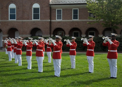 """The Commandant's Own"" performs for the Passage of Command between Gen. Joseph F. Dunford Jr., 36th commandant of the Marine Corps, and Gen. Robert B. Neller, 37th commandant of the Marine Corps, at Marine Barracks Washington, D.C., Sept. 24, 2015."