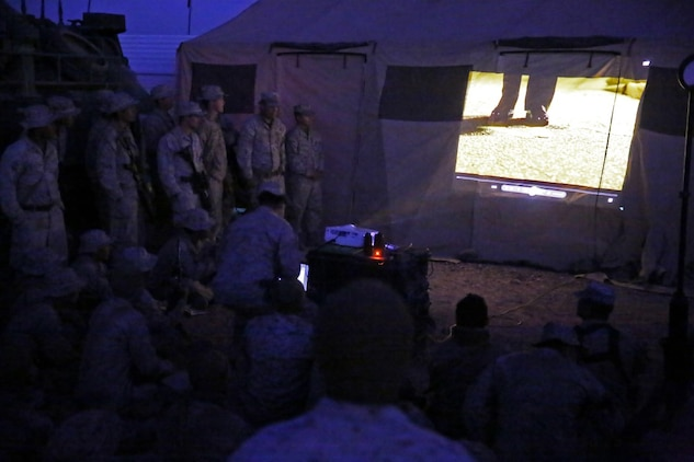 Marines and Sailors assigned to Company A, 3rd Assault Amphibian Battalion, 1st Marine Division, watch the commandant's birthday message in celebration of the Marine Corps' 240th birthday aboard Yuma Proving Grounds, Ariz., Nov. 10, 2015. The Marines and Sailors celebrated the birthday as a culminating event to the 18-day field operation.