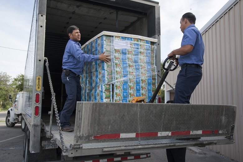 Volunteers offload a pallet of canned vegetables donated to the Val Verde Loaves and Fishes food pantry in Del Rio, Texas, Nov. 12, 2015. Laughlin Air Force Base personnel and their families donated more than 24,000 pounds of food to the pantry as part of the 2015 Feds Feed Families campaign, placing Laughlin in fifth place for total contributions in the Air Force. (U.S. Air Force photo by Staff Sgt. Nathan Maysonet)