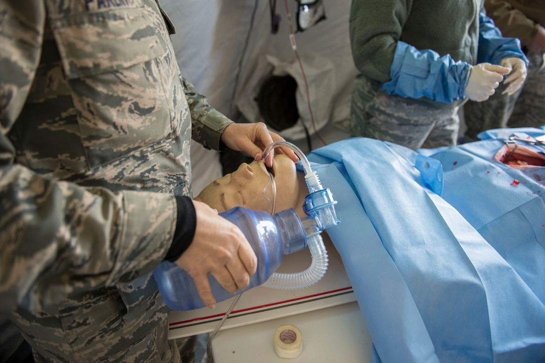 Maj. Cynthia Parent, a 141st Medical Group nurse anesthetist, simulates manual ventilation on a manikin during Gunfighter Flag 16-1 at Mountain Home Air Force Base, Idaho, Nov. 5, 2015. Parent is part of an Air National Guard unit out of Spokane, Wash. (U.S. Air Force photo/Airman 1st Class Jessica H. Evans)