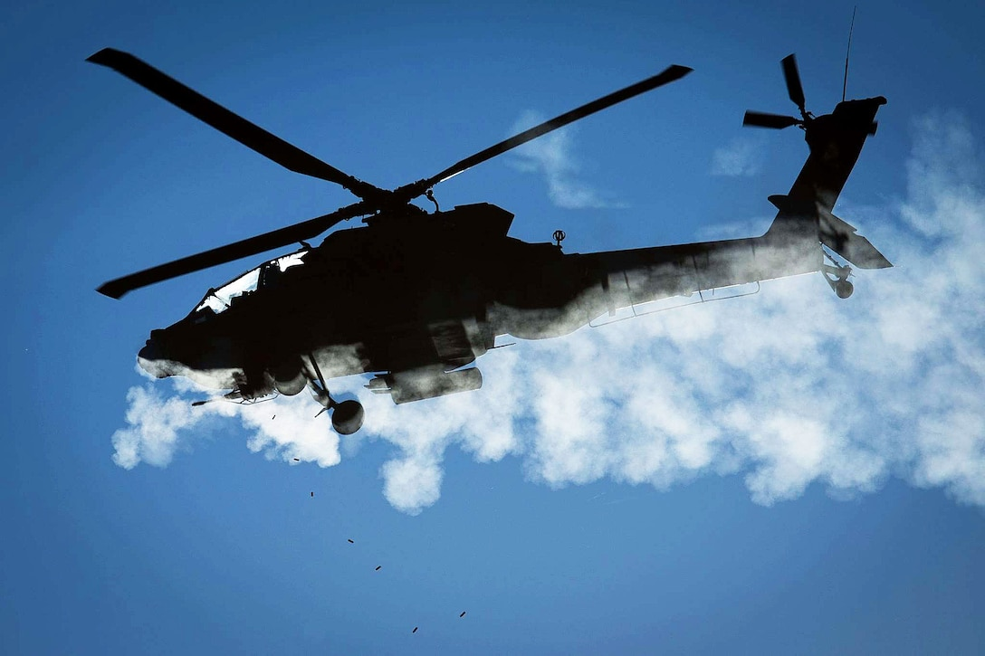 Army Lt. Col. Scott Nicholas and Chief Warrant Officer 3 Fred Heer fly a Texas Army National Guard AH-64D Apache helicopter while firing a 30 mm cannon during an aerial gunnery exercise on Fort Hood, Texas, Nov. 9th, 2015. U.S. Army photo by Major Randy Stillinger