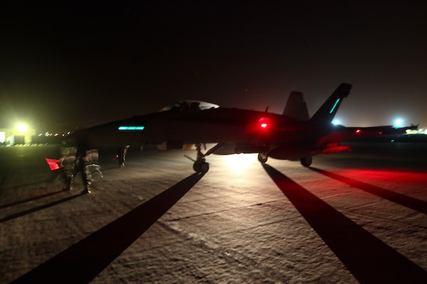 U.S. Marine aviation ordnance technicians with Marine Fighter Attack Squadron-232, Special Purpose Marine Air-Ground Task Force—Crisis Response—Central Command, prepare an F/A-18 Hornet to launch for a strike mission in Southwest Asia, June 9, 2015. Pilots of VMFA-232 support Combined Joint Task Force – Operation Inherent Resolve with a combination of surveillance flights and kinetic strike missions, enabling Iraqi Security Forces in their fight against the Islamic State of Iraq and the Levant. (U.S. Marine Corps Photo by Cpl. Leah Agler)