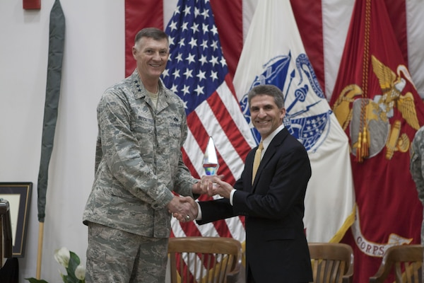 DLA director Air Force Lt. Gen. Andrew E. Busch presents Robert Montefour, site director of Defense Distribution Center, Susquehanna Installation Support the Commander in Chief's Annual Award for Installation Excellence.