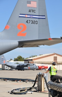 Two MAFFS-equipped C-130 aircraft from the Air Force Reserve Command's 302nd Airlift Wing load up with retardant at McClellan Air Field Calif., Aug. 3, 2015. The aircraft began flying suppression missions on California fires within an hour of their initial arrival at the air field. The Colorado-based wing's aircraft, crews and support personnel provided fire suppression support in California for one month. (U.S. Air Force photo/Master Sgt. Daniel Butterfield)