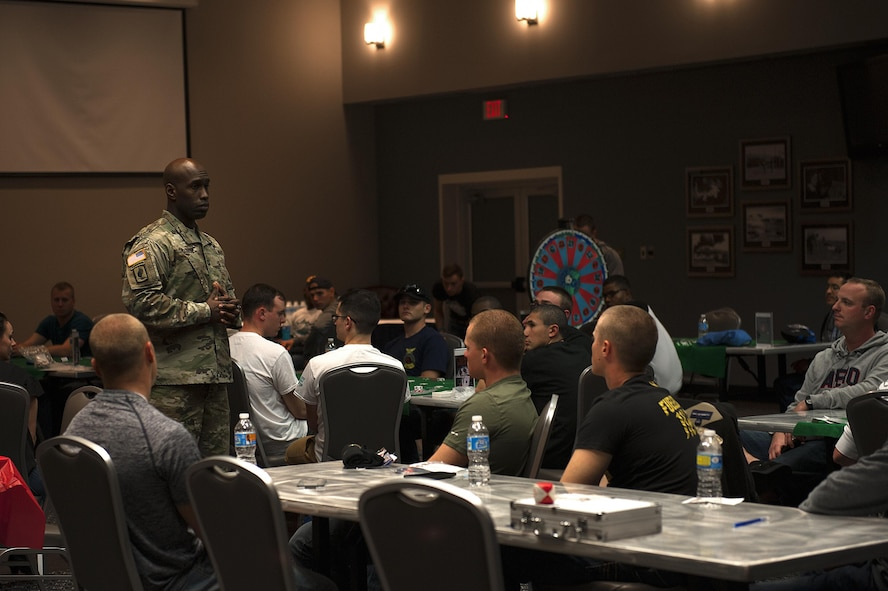 U.S. Army Capt. Jeremy Dillard, 344th Military Intelligence Battalion Alpha Company Commander, shares his experiences and stories about resiliency among comrades during 4th Annual Sexual Assault Prevention and Response Guys Night Out at the Event Center on Goodfellow Air Force Base, Texas, Nov. 12, 2015. Dillard was one of multiple guest speakers to speak about resiliency and sexual assault awareness. (U.S. Air Force photo by Airman 1st Class Caelynn Ferguson/Released)