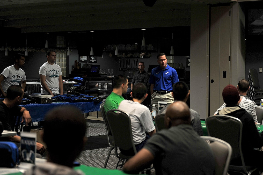 U.S Air Force Col. Michael Grunwald Jr., 17th Training Group Commander, speaks about sexual assault and how beneficial it is to utilize the programs available for Airmen during the 4th Annual Sexual Assault Prevention and Response Guys Night Out at the Event Center on Goodfellow Air Force Base, Texas, Nov. 11, 2015. Col. Grunwald was one of multiple guest speakers to speak about resiliency and sexual assault awareness. (U.S. Air Force photo by Airman 1st Class Caelynn Ferguson/Released)