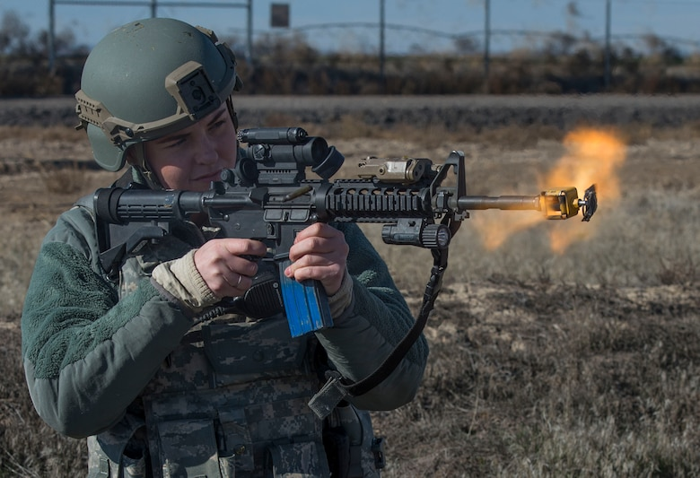 Airman 1st Class Alexis Dinger, 366th Security Forces Squadron response force leader, fires her final rounds to clear her weapon during Gunfighter Flag 16-1 Nov. 6, 2015, at Mountain Home Air Force Base, Idaho. At the end of an exercise, security forces members expend extra rounds rather than saving them to promote easy accountability and avoid storage of expired ammunition. (U.S. Air Force photo by Airman Chester Mientkiewicz/RELEASED)