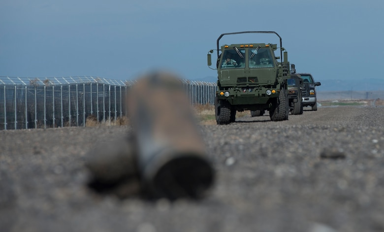 A 366th Security Forces Squadron 5-ton truck approaches a simulated improvised explosive device during Gunfighter Flag 16-1 Nov. 6, 2015, at Mountain Home Air Force Base, Idaho. IEDs are one of the primary threats deployed airmen face with more than 26,000 IED events causing approximately 55,000 casualties worldwide 2014 alone, according to Army officials. (U.S. Air Force photo by Airman Chester Mientkiewicz/RELEASED)