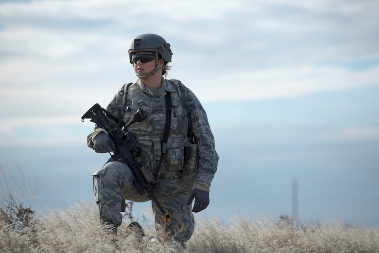 Airman 1st Class Alexis Dinger, 366th Security Forces Squadron response force leader, kneels while patrolling an area during Gunfighter Flag 16-1 Nov. 5, 2015, at Mountain Home Air Force Base, Idaho. The goal of the patrol was to gather Intelligence on the simulated enemy. (U.S. Air Force photo by Airman Chester Mientkiewicz/RELEASED)