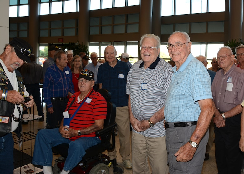 Oklahoma Veterans from WWII and the Korean War gather in the lobby of the Hudiburg Center prior the start of the Honor Flight reception ceremony Sept. 15, 2015, in Midwest City, Okla. Eighty-one Oklahoma veterans flew to Washington, D.C. the following day to visit memorials built in their honor as part of the Oklahoma Honor Flight Program. (U.S. Air Force photo by Tech. Sgt. Lauren Gleason)