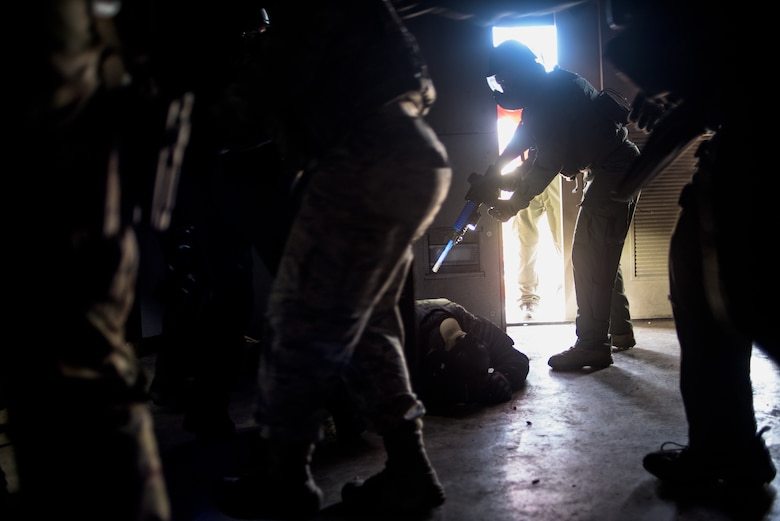 Airmen from the Will Rogers Air National Guard Base in Oklahoma City, and Oklahoma law enforcement officers neutralize a threat to save a hostage at a fire training center in Edmond during a Special Weapons and Tactics school held by the Oklahoma County Sheriff's Office, Oct. 26 to Nov. 6, 2015. Oklahoma Air National Guard Airmen and six other state agencies executed precise joint operations and procedures that may one day be used to save lives in real-world situations. (U.S. Air National Guard photo by Master Sgt. Andrew M. LaMoreaux)