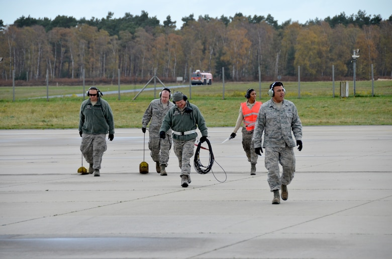 Aircraft maintainers from the 161st Air Refueling Wing finish launching a KC-135 Stratotanker Nov. 13 at NATO Air Base Geilenkirchen, Germany. Arizona Air National Guard members from Phoenix are supporting NATO E-3A Sentry aircrew training operations here Nov. 9-20. (U.S. Air National Guard photo by Lt. Col. Gabe Johnson)