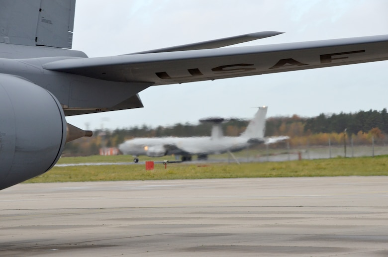 A NATO E-3A Sentry takes off from NATO Air Base Geilenkirchen, Germany, Nov. 13 while an Arizona Air National Guard KC-135 Stratotanker  prepares for launch. Both aircraft rendezvoused over northern Germany during a training mission to practice air refueling. Airmen from the 161st Air Refueling Wing based in Phoenix are supporting aircrew training operations here Nov. 9-20. (U.S. Air National Guard photo by Lt. Col. Gabe Johnson)