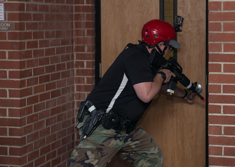 A law enforcement officer prepares to breach a door during an active shooter exercise at the Federal Law Enforcement Training Center in Charleston, S.C., on Nov. 5, 2015. The active shooter training program is a four day course to help law enforcement officers better handle an actual active shooter situation. (U.S. Air Force photo/Airman 1st Class Thomas T. Charlton)