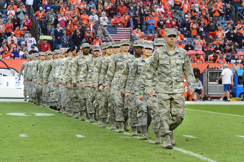 U.S. Air Force members march onto the field Nov. 15, 2015, at Sports Authority Field at Mile High Stadium, Denver. The Denver Broncos held their Salute to Service game on Sunday against the Kansas City Chiefs and honored military members before the game and during halftime. (U.S. Air Force photo by Airman 1st Class Luke W. Nowakowski/Released)