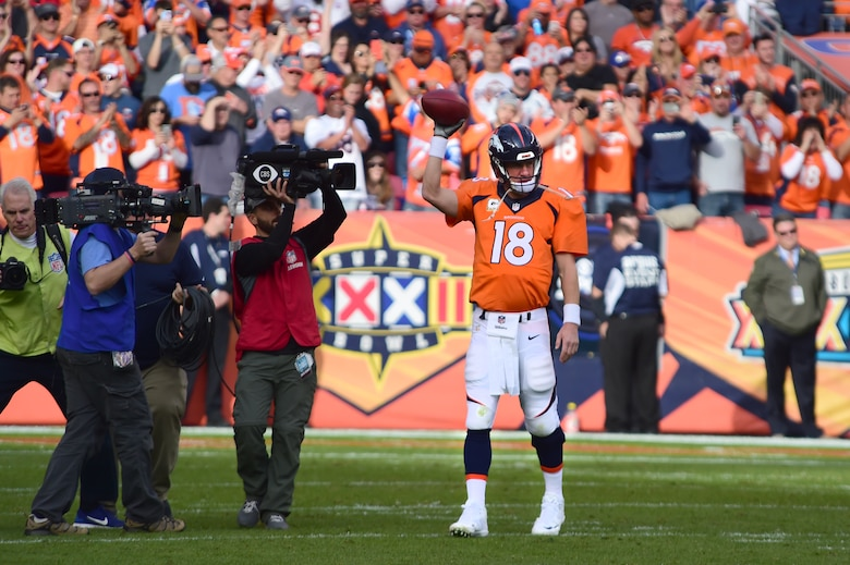 Peyton Manning, quarterback for the Denver Broncos, breaks the career passing yard record Nov. 15, 2015, at Sports Authority Field at Mile High Stadium, Denver. Manning reached 71,840 passing yards for his career, overtaking Brett Favre as the all-time passing yards leader. (U.S. Air Force photo by Airman 1st Class Luke W. Nowakowski/Released)