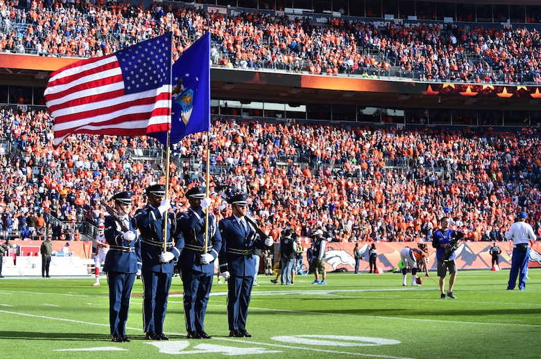 Buckley Air Force Base Honor Guard presents the colors Nov. 15, 2015, at Sports Authority Field at Mile High Stadium, Denver. The Denver Broncos hosted military members at their Salute to Service game against the Kansas City Chiefs. (U.S. Air Force photo by Airman 1st Class Luke W. Nowakowski/Released)