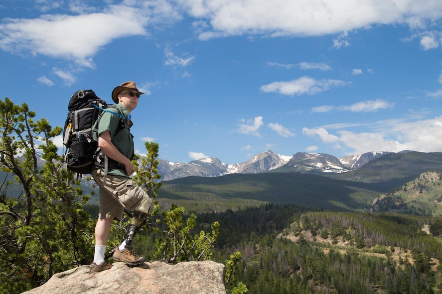 PETERSON AIR FORCE BASE, Colo. - Army Maj. Rob Callahan looks out at the view during a backpacking trip near Estes Park in 2014. Callahan lost his right leg to bone cancer in 2004 and after enduring many years of physical therapy was able to pass the Army physical fitness test using a prosthetic leg. (Courtesy photo by Becky Callahan)