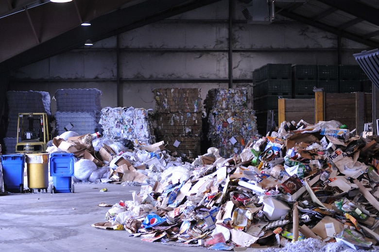 Recycled cardboard material is piled up inside the Civil Engineering Recycling Center located in Area A, Bldg. 293. America Recycles Day on Nov. 15 will help to promote recycling and the center will host an open house from 8 a.m. to 3 p.m. (U.S. Air Force photo/Mary H. Allen)