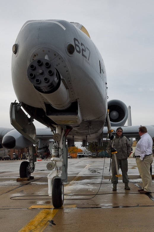 Kevin Miller of KIDO radio in Boise, speaks to 124th Maintenance Group, Crew Chief, Master Sgt. Alan Stoker about the A-10 Thunderbolt II after the broadcast of his morning show from the 124th Fighter Wing, Boise, Idaho on Nov. 10, 2015. Miller spoke with six members of the Idaho Air National Guard on the show about their experiences in the National Guard, work-life balance, and the greater mission and future of the 124th Fighter Wing.   (Air National Guard photo by Tech. Sgt. Sarah Pokorney/Released)
