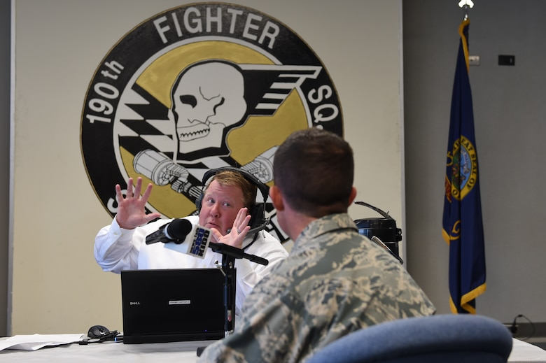 Kevin Miller of KIDO radio in Boise, interviews Major Chris Borders, Idaho National Guard public affairs officer, during the broadcast of his morning talk show on Nov. 10, 2015 from the 124th Fighter Wing, Boise, Idaho. Miller spoke with six members of the Idaho Air National Guard about their experiences in the National Guard, work and life balance, and the greater mission and future of the 124th Fighter Wing.   (Air National Guard photo by Tech. Sgt. Sarah Pokorney/Released)