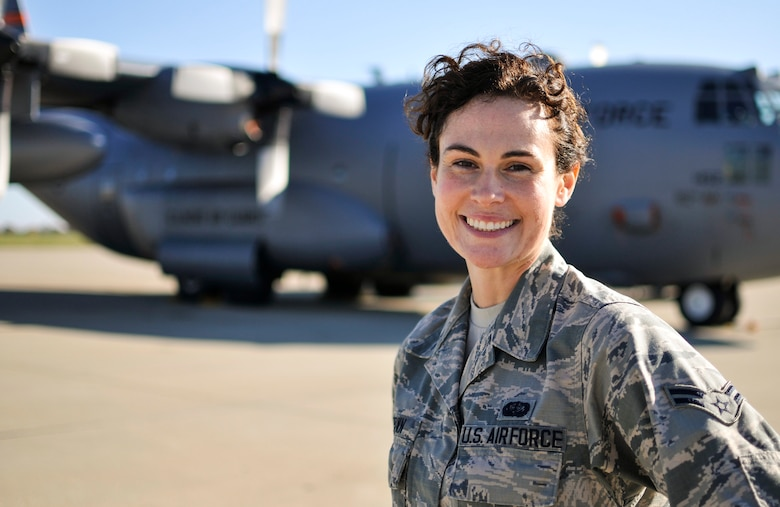 U.S. Air Force Airman 1st Class Tanya L. Brown, a services journeyman with the 182nd Force Support Squadron, Illinois Air National Guard, poses on the 182nd Airlift Wing aircraft apron in Peoria, Ill., Nov. 7, 2015. Brown – a full-time beautician, farmer, student, wife and mother - enlisted in the Air National Guard at the age of 35. (U.S. Air National Guard photo by Staff Sgt. Lealan Buehrer/Released)