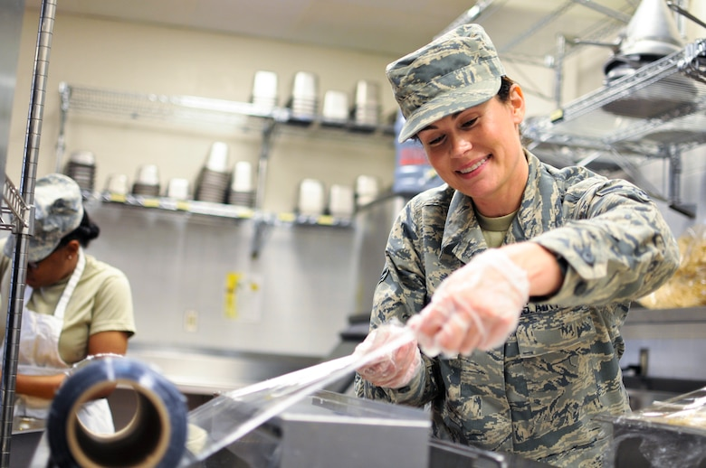 U.S. Air Force Airman 1st Class Tanya L. Brown, a services journeyman with the 182nd Force Support Squadron, Illinois Air National Guard, wraps food after lunch at the 182nd Airlift Wing in Peoria, Ill., May 2, 2015. Brown – a full-time beautician, farmer, student, wife and mother - enlisted in the Air National Guard at the age of 35. (U.S. Air National Guard photo by Staff Sgt. Lealan Buehrer/Released)