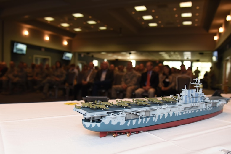A small scale model representing the aircraft carrier the Doolittle Raiders took off from sits on display during a Q-and-A session with one of the last Doolittle Raiders at the Event Center on Goodfellow Air Force Base, Texas, Nov. 12, 2015. Retired Lt. Col. Richard E. Cole, Doolittle Raider, spoke to an audience of more than 200 individuals. (U.S. Air Force photo by Senior Airman Joshua Edwards/Released)