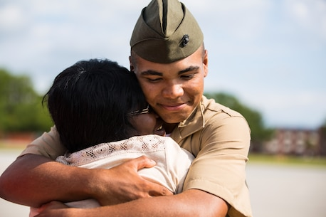 A new Marine of Fox Company, 2nd Recruit Training Battalion, greets his family following his graduation ceremony June 5, 2015, on Parris Island, S.C. The Marines spent nearly 13 weeks away from home training to earn their places in the Corps. (Photo by Sgt. Jennifer Schubert)