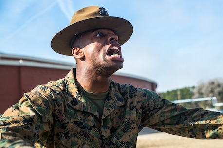 Drill Instructor Staff Sgt. Maurice S. Jones, with Platoon 3038, India Company, 3rd Recruit Training Battalion, encourages his recruits to push themselves through an incentive training session March 5, 2015, on Parris Island, S.C. Discipline, defined as the instant and willing obedience to all orders, respect for authority and self-reliance, is a key trait drill instructors, such as Jones, 28, from Philadelphia, must instill in recruits. India Company is scheduled to graduate May 15, 2015. Parris Island has been the site of Marine Corps recruit training since Nov. 1, 1915. Today, approximately 20,000 recruits come to Parris Island annually for the chance to become United States Marines by enduring 13 weeks of rigorous, transformative training. Parris Island is home to entry-level enlisted training for 50 percent of males and 100 percent of females in the Marine Corps. (Photo by Sgt. Jennifer Schubert)