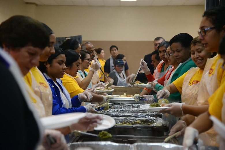 Volunteers assemble plates of food at the Del Rio Civic Center in Del Rio, Texas, Nov. 14, 2015. Volunteers at the H-E-B Feast of Sharing distributed 3,000 pounds of turkey, 2,500 pounds of cornbread dressing, 750 pumpkin pies, 380 gallons of mashed potatoes, 140 gallons of turkey gravy and 95 gallons of cranberry sauce. (U.S. Air Force photo by Airman 1st Class Brandon May)