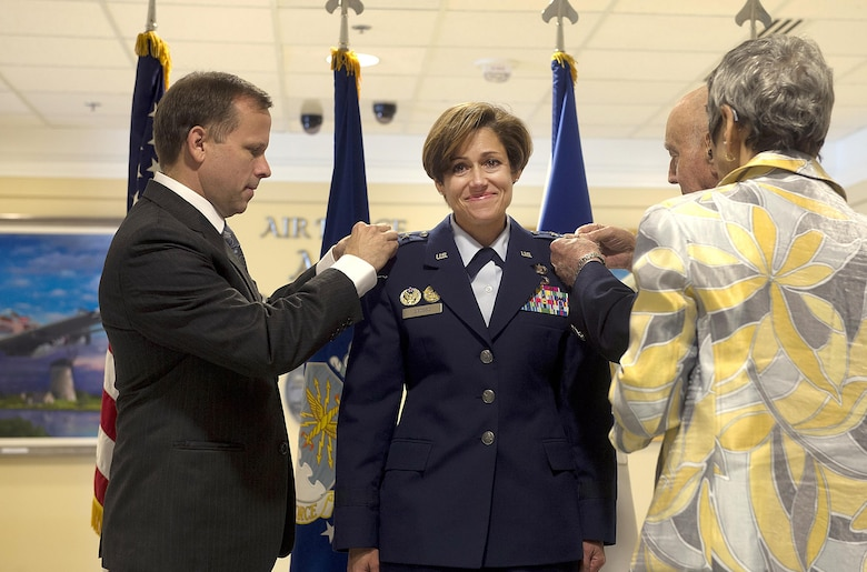 Retired Air Force Col. Brian O'Connor, Dr. Camille Grosso, and retired Air Force Lt. Col. Gerry Grosso help pin Lt. Gen. Gina Grosso's new rank during her promotion ceremony in the Pentagon, Nov. 16, 2015. Grosso is the 31st Airman to serve as the Air Force's deputy chief of staff for manpower, personnel and services in the 47 years of the position's existence.  (U.S. Air Force photo/Jim Varhegyi)