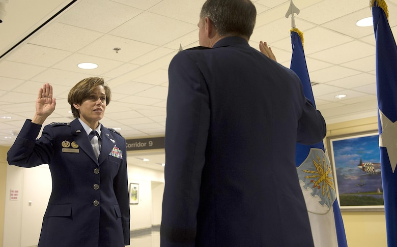 Air Force Vice Chief of Staff Gen. David L. Goldfein, right, gives the oath of office to Lt. Gen. Gina Grosso during her promotion ceremony in the Pentagon, Nov. 16, 2015. Grosso is the 31st Airman to serve as the Air Force's deputy chief of staff for manpower, personnel and services in the 47 years of the position's existence. (U.S. Air Force photo/Jim Varhegyi)