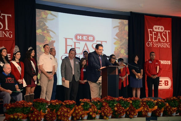 Members of the Del Rio community speak at the H-E-B Feast of Sharing at the Del Rio Civic Center in Del Rio, Texas, Nov. 14, 2015. The Feast of Sharing is the culmination of a year round commitment H-E-B makes to fighting hunger and includes music, arts and crafts, and kids' activities. (U.S. Air Force photo by Airman 1st Class Brandon May)