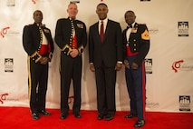 Lieutenant Colonel Brian Proctor (left), Lt. Gen. Mark A. Brilakis, Johnny C. Taylor Jr., and Sgt. Maj. Samuel Heyward Jr. meet during the 2015 Thurgood Marshall College Fund 27th annual Awards Gala in Washington D.C., Nov. 16. The ceremony is the culminating event of the TMCF Leadership Institute, a three day conference and career day for Historically Black Colleges and University students held in honor of civil rights activist Thurgood Marshall. Proctor currently serves as the Officer in Charge of Diversity with Marine Corps Recruiting Command aboard Marine Corps Base Quantico, Va. Brilakis currently serves as the Commanding General of MCRC. Taylor is the President and CEO of the TMCF. Heyward serves as the Sergeant Major of MCRC.