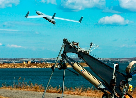 "A Scan Eagle unmanned aerial vehicle launches from the Naval Surface Warfare Center Dahlgren Division (NSWCDD) Potomac River Test Range during a surface warfare integration test featuring the virtual USS Dahlgren. Scan Eagle identified, targeted, engaged and supported reengagement throughout the experiment as the NSWCDD-patented Visual Automatic Scoring System sent gun targeting corrections to the MK160 gun weapon system operator. ""USS Dahlgren is empowering our integration of unmanned air and surface vehicles into the fire-control-loop for greatly expanded battle space and increased reaction times,"" said Neil Baron, NSWCDD distinguished scientist for combat control."
