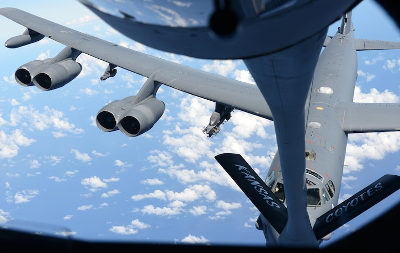 A U.S. Air Force B-52 Stratofortress connects to a KC-135 Stratotanker during an aerial refueling exercise Nov. 6, 2015, near Andersen Air Force Base, Guam. The B-52 crews are a part of the U.S. Pacific Command's continuous bomber presence and support ongoing operations in the Indo- Asia-Pacific region. (U.S. Air Force photo by Airman 1st Class Arielle Vasquez/Released)