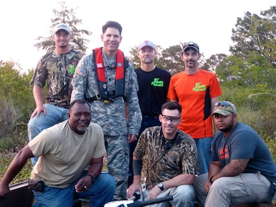 Fort Worth District deputy commander, Lt. Col. Clay Morgan poses with wounded warriors during an alligator hunt at B.A. Steinhagen Lake, near Jaspar, Texas.