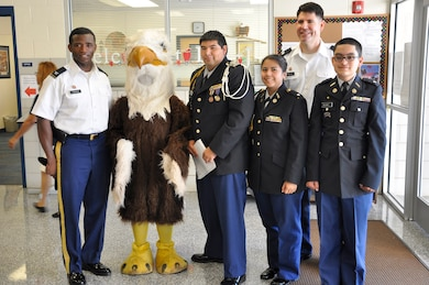 "Fort Worth District commander and deputy pose with JROTC students before the ""Project Lead the Way"" program with the Fort Worth Independent School District."