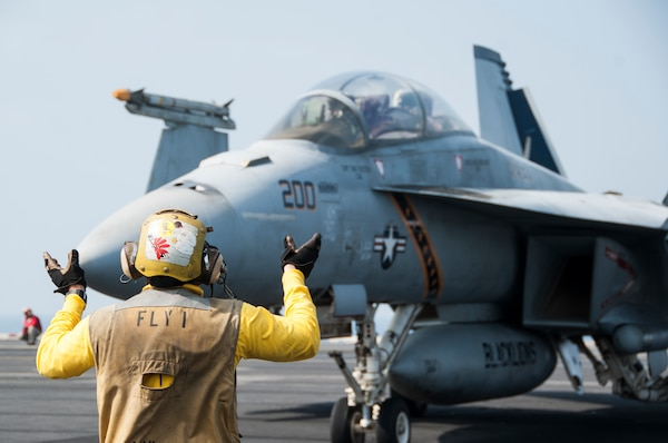 An F/A-18F Super Hornet attached to Strike Fighter Squadron 213 taxis on the flight deck of the aircraft carrier USS George H.W. Bush, Nov. 16, 2015. George H.W. Bush is supporting maritime security operations, strike operations in Iraq and Syria as directed, and theater security cooperation efforts in the U.S. 5th Fleet area of responsibility. U.S. Navy photo by Petty Officer 3rd Class Brian Stephens