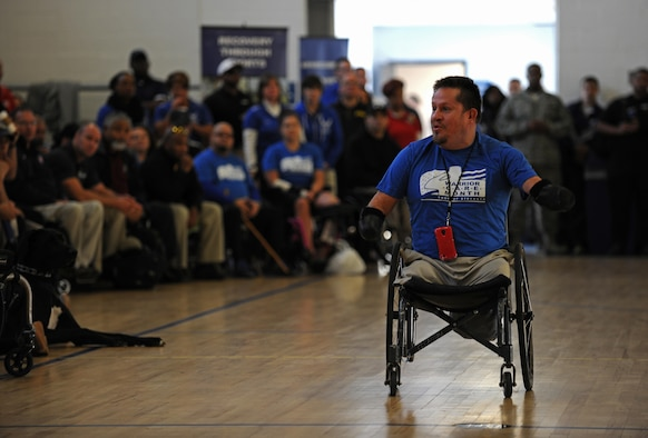 Bob Lujano, a Paralympic athlete, speaks to wounded warriors at the opening ceremonies of the Northeast Region Warrior CARE Event at Joint Base Andrews, Md., Nov. 16, 2015. The event is held in conjunction with Warrior Care Month, a month dedicated to honoring the courage, resilience and accomplishments of wounded, ill and injured service members, their families and their caregivers. (U.S. Air Force photo/Tech. Sgt. Brian Ferguson)