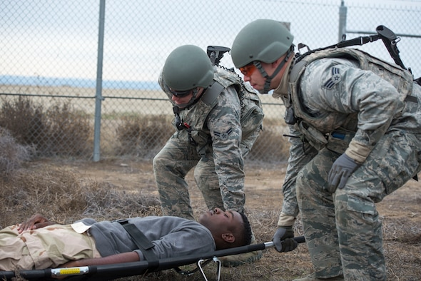 Members of the 366th Security Forces Squadron lift a stretcher with a simulated vehicle rollover victim during Gunfighter Flag 16-1 Nov. 6, 2015, at Mountain Home Air Force Base, Idaho. With SFS members usually being first responders, they often perform self-aid and buddy care in critical situations. (U.S. Air Force photo by Airman Chester Mientkiewicz)