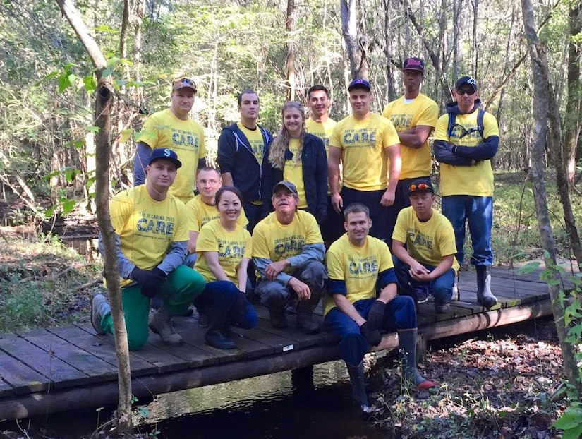 Members from Joint Base Charleston pose for a group photo after clearing and repairing trails in the Francis Marion National Forest, S.C. on Nov. 13, 2015. Thirteen people donated five hours of their time each in order to put three bridges back into place and clear the trails of leaves and debris caused from recent flooding in the Lowcountry. This volunteer event was a part of this year's United Way Day of Caring. (Courtesy photo)