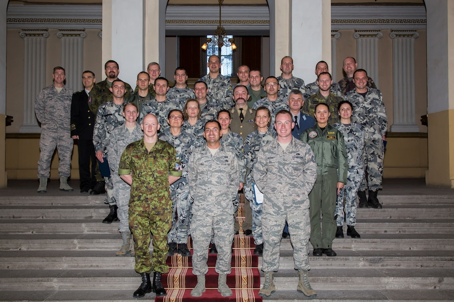 Students and instructors pose for a photo after graduation from the first ever IEAFA combined international officer and NCO PME course in Sofia, Bulgaria, Nov. 13, 2015.  Twenty-three students from Bulgaria, Czech Republic, Estonia, and Hungary participated in the inaugural course. (U.S. Air Force photo/SMSgt Travis Robbins/Released)