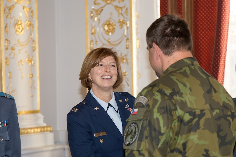 Colonel Jill Long, Deputy Director Plans and Program Analyses, congratulates Sgt. 1st Class Pavel Zelenka from the Czech Republic Air Force on his completion of the first IEAFA combined international officer and NCO PME course during graduation in Sofia, Bulgaria, Nov. 13, 2015.  Twenty-three students from Bulgaria, Czech Republic, Estonia, and Hungary participated in this inagural course. (U.S. Air Force photo/SMSgt Travis Robbins/Released)