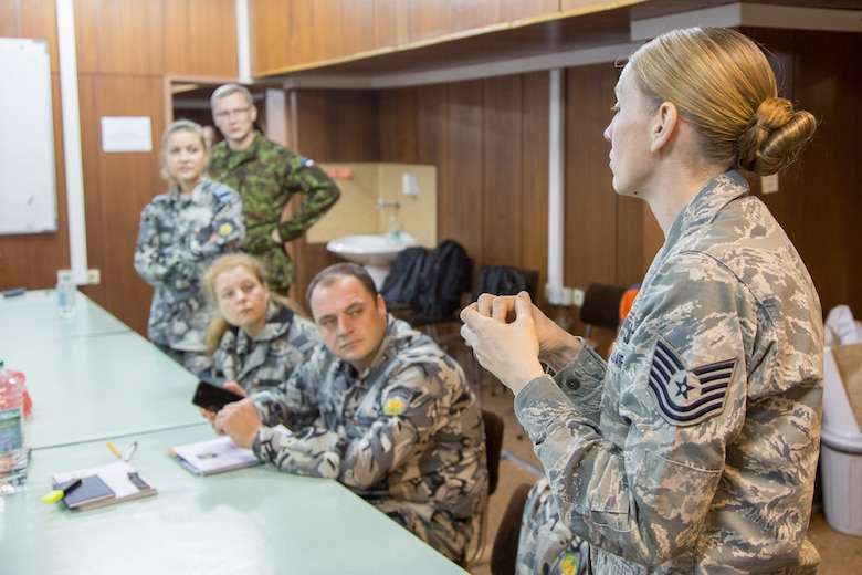 Tech. Sgt. Sandra Wellman, a Kisling NCOA instructor, talks about the critical role NCOs play in USAF operations with international students during the first ever IEAFA combined international officer and NCO PME course held in Sofia, Bulgaria, Nov. 2-13, 2015.  Twenty-three students from Bulgaria, Czech Republic, Estonia, and Hungary participated in this inagural course (U.S. Air Force photo/SMSgt Travis Robbins/Released)